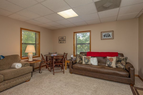 Sofa and table with four chairs at One Blessed Nest, a 3 bedroom cabin rental located in Pigeon Forge