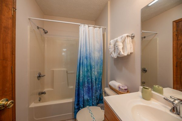 Bathroom with a tub and shower at One Blessed Nest, a 3 bedroom cabin rental located in Pigeon Forge