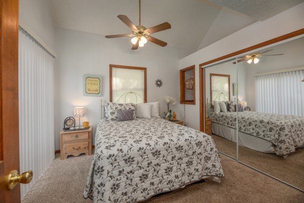 Bedroom with two nightstands and two lamps at One Blessed Nest, a 3 bedroom cabin rental located in Pigeon Forge