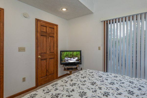 TV and closet in a bedroom at One Blessed Nest, a 3 bedroom cabin rental located in Pigeon Forge