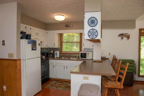Breakfast bar and kitchen at One Blessed Nest, a 3 bedroom cabin rental located in Pigeon Forge