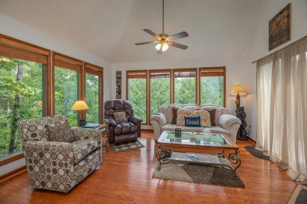 Living room with sofa, loveseat, and chair at One Blessed Nest, a 3 bedroom cabin rental located in Pigeon Forge