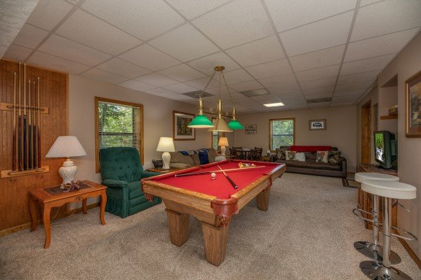 Red felt pool table at One Blessed Nest, a 3 bedroom cabin rental located in Pigeon Forge