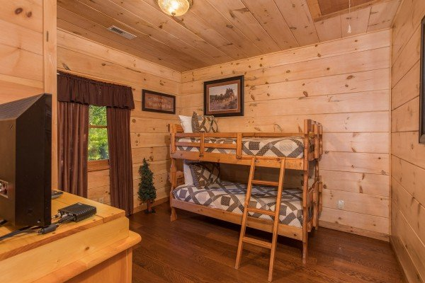 Twin bunk bed on the lower floor at Patriot Pointe, a 5 bedroom cabin rental located in Pigeon Forge