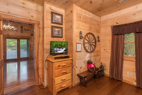 Dresser and TV in the bunk room at Patriot Pointe, a 5 bedroom cabin rental located in Pigeon Forge