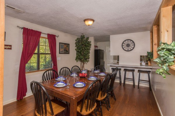 Dining table for 8 with counter seating for three at Patriot Pointe, a 5 bedroom cabin rental located in Pigeon Forge