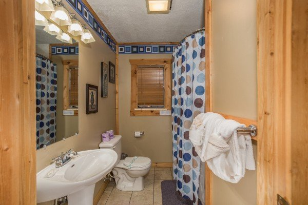 Bathroom with shower and tub at Patriot Pointe, a 5 bedroom cabin rental located in Pigeon Forge