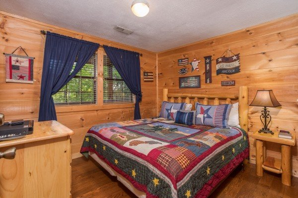 King log bed at Patriot Pointe, a 5 bedroom cabin rental located in Pigeon Forge