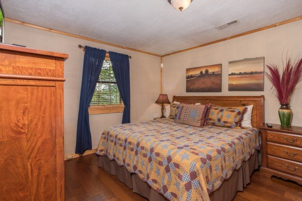 King sized bed at Patriot Pointe, a 5 bedroom cabin rental located in Pigeon Forge