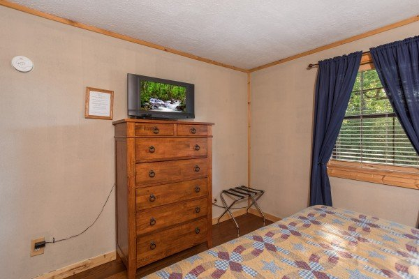 Chest of drawers and TV at Patriot Pointe, a 5 bedroom cabin rental located in Pigeon Forge