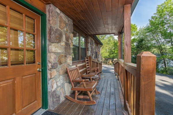 Covered front porch at Patriot Pointe, a 5 bedroom cabin rental located in Pigeon Forge