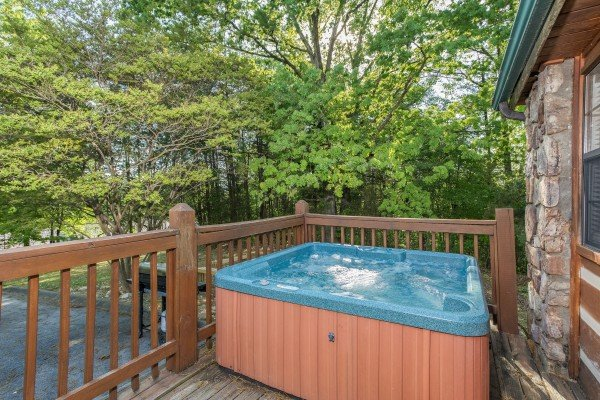 Hot tub on a deck at Patriot Pointe, a 5 bedroom cabin rental located in Pigeon Forge