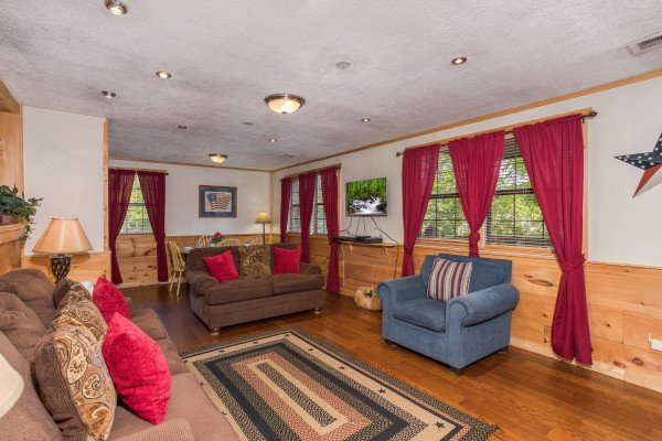 Sofa, loveseat, and chair in the living room at Patriot Pointe, a 5 bedroom cabin rental located in Pigeon Forge