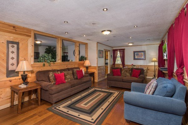 Living room with sofa, loveseat, and chair at Patriot Pointe, a 5 bedroom cabin rental located in Pigeon Forge