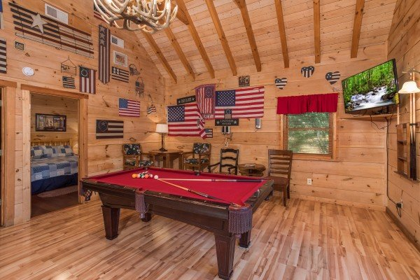 Pool table in the game room at Patriot Pointe, a 5 bedroom cabin rental located in Pigeon Forge