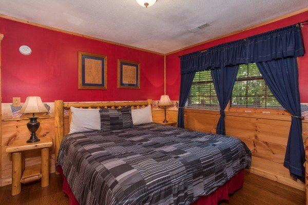 Bedroom with a king bed at Patriot Pointe, a 5 bedroom cabin rental located in Pigeon Forge
