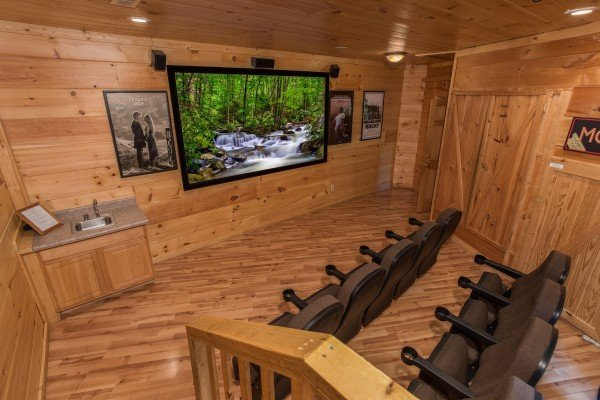 Theater room with a small wet bar at Patriot Pointe, a 5 bedroom cabin rental located in Pigeon Forge