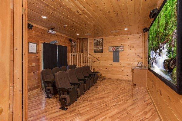 Seating in the theater room at Patriot Pointe, a 5 bedroom cabin rental located in Pigeon Forge