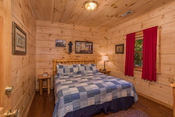 King bedroom at Patriot Pointe, a 5 bedroom cabin rental located in Pigeon Forge