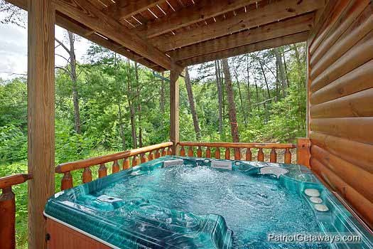 first floor deck with jacuzzi at wilderness lodge a 3 bedroom cabin rental located in pigeon forge