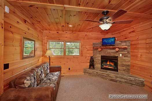 game room with fireplace at wilderness lodge a 3 bedroom cabin rental located in pigeon forge
