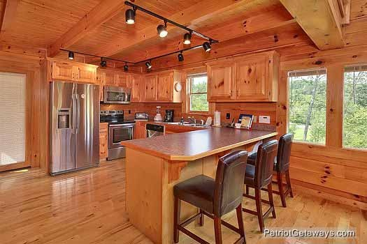 kitchen with island at wilderness lodge a 3 bedroom cabin rental located in pigeon forge