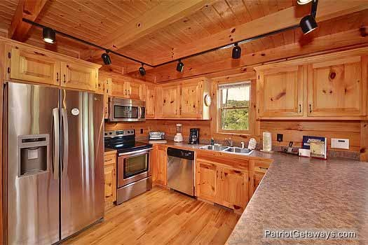kitchen with stainless steel appliances at wilderness lodge a 3 bedroom cabin rental located in pigeon forge