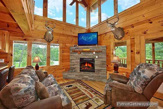 living room with fireplace at wilderness lodge a 3 bedroom cabin rental located in pigeon forge