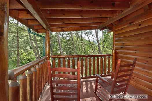 lower deck with chairs at wilderness lodge a 3 bedroom cabin rental located in pigeon forge