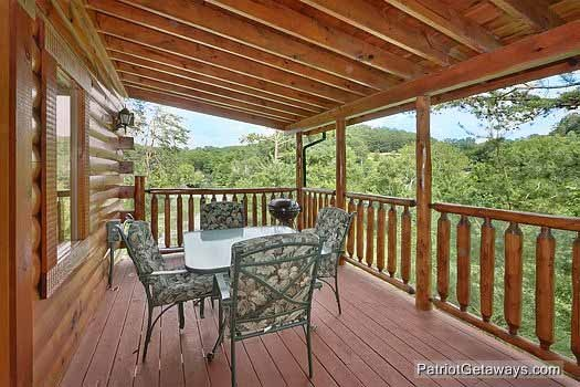 main level deck with grill and dining set at wilderness lodge a 3 bedroom cabin rental located in pigeon forge