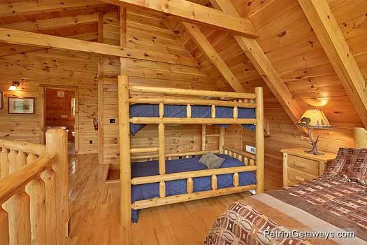 twin bunk beds in lofted bedroom at wilderness lodge a 3 bedroom cabin rental located in pigeon forge