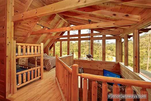 view of lofted bedroom at wilderness lodge a 3 bedroom cabin rental located in pigeon forge