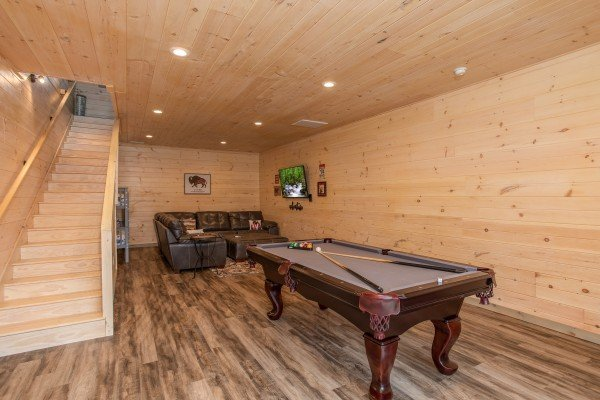 Pool table in the TV room at Sugar Bear, a 3 bedroom cabin rental located in Pigeon Forge