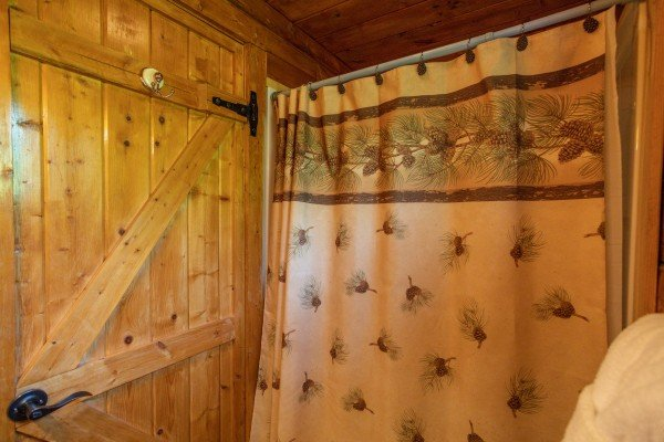Bathroom with tub and shower at Mountain Breeze, a 1 bedroom cabin rental located in Pigeon Forge