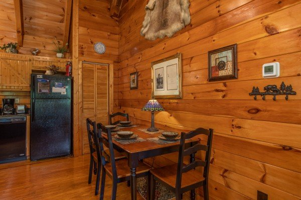 Dining table for four off the kitchen at Mountain Breeze, a 1 bedroom cabin rental located in Pigeon Forge