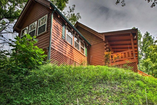 Looking up at the cabin from the driveway at Mountain Breeze, a 1 bedroom cabin rental located in Pigeon Forge
