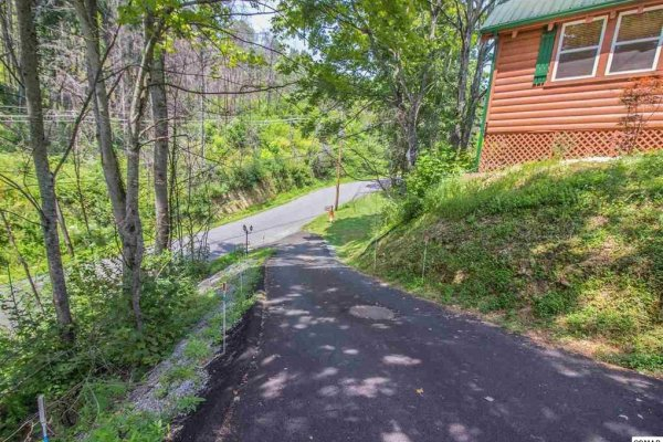 Looking down the driveway at the main road at Mountain Breeze, a 1 bedroom cabin rental located in Pigeon Forge