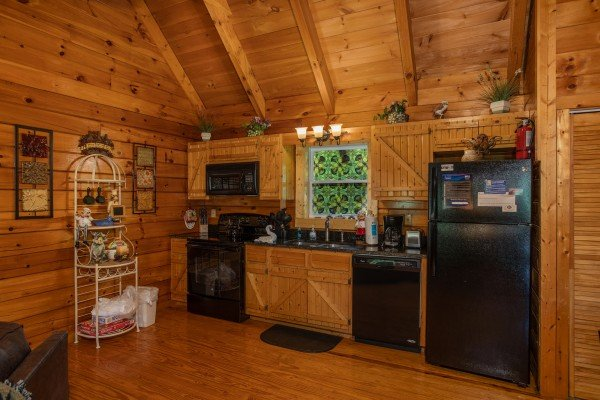 Kitchen with black appliances at Mountain Breeze, a 1 bedroom cabin rental located in Pigeon Forge