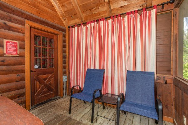 Screened in porch at Mountain Breeze, a 1 bedroom cabin rental located in Pigeon Forge