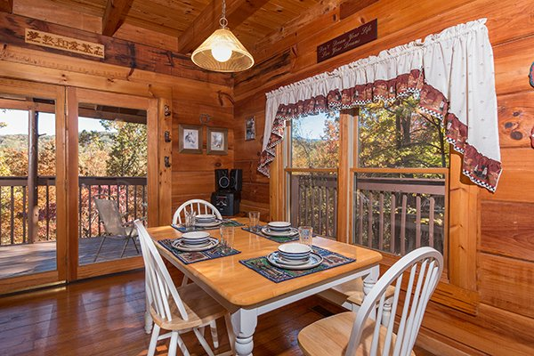 Dining table for four at Hawk's Nest, a 1-bedroom cabin rental located in Pigeon Forge