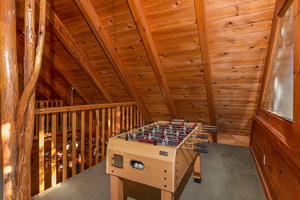 Foosball table in the loft space at Hawk's Nest, a 1-bedroom cabin rental located in Pigeon Forge