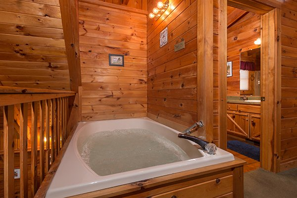 Jacuzzi tub in the loft bedroom at Hawk's Nest, a 1-bedroom cabin rental located in Pigeon Forge