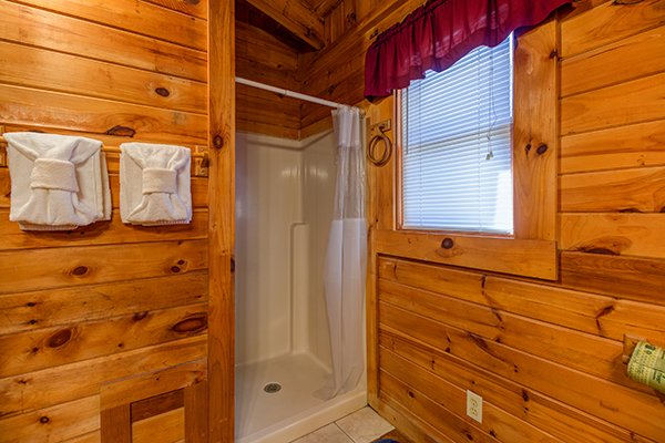 Shower in the loft bathroom at Hawk's Nest, a 1-bedroom cabin rental located in Pigeon Forge
