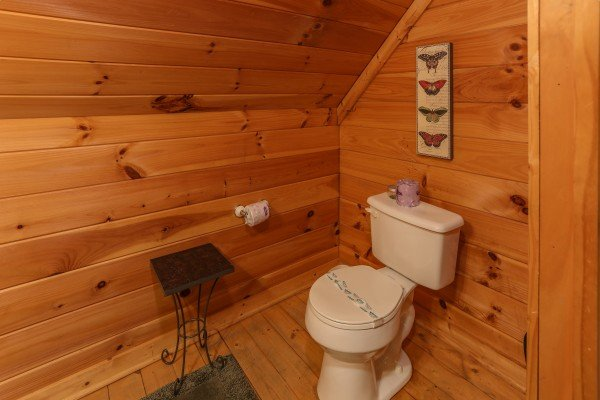 Bathroom in the game loft at Hidden Ecstasy, a 1-bedroom cabin rental located in Pigeon Forge