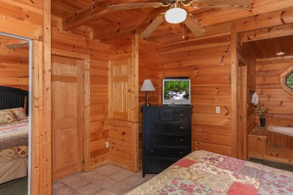 Chest of drawers and TV in the bedroom at Hidden Ecstasy, a 1-bedroom cabin rental located in Pigeon Forge