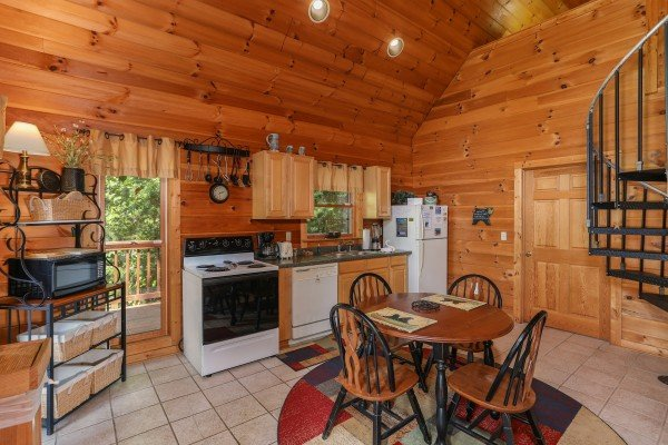 Dining space for four in a kitchen at Hidden Ecstasy, a 1-bedroom cabin rental located in Pigeon Forge