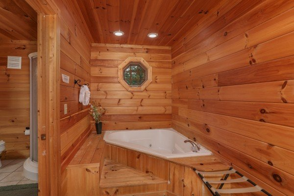 Jacuzzi in the bedroom at Hidden Ecstasy, a 1-bedroom cabin rental located in Pigeon Forge