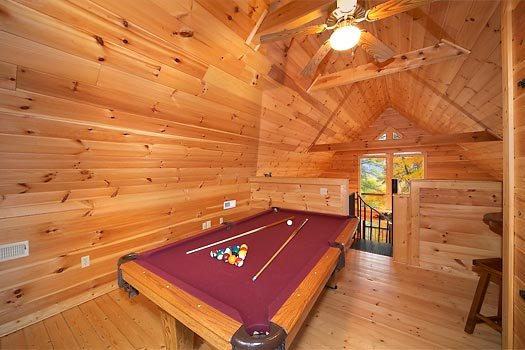 Lofted game room at Hidden Ecstasy, a 1-bedroom cabin rental located in Pigeon Forge