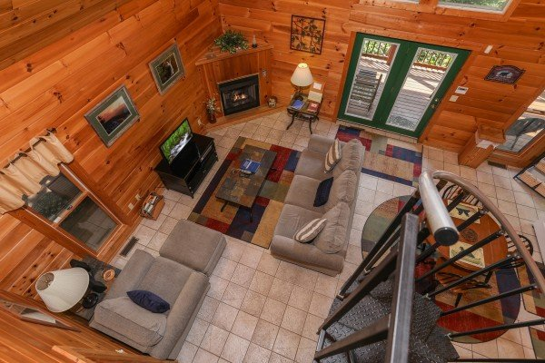 Looking down on the spiral staircase and living room at Hidden Ecstasy, a 1-bedroom cabin rental located in Pigeon Forge