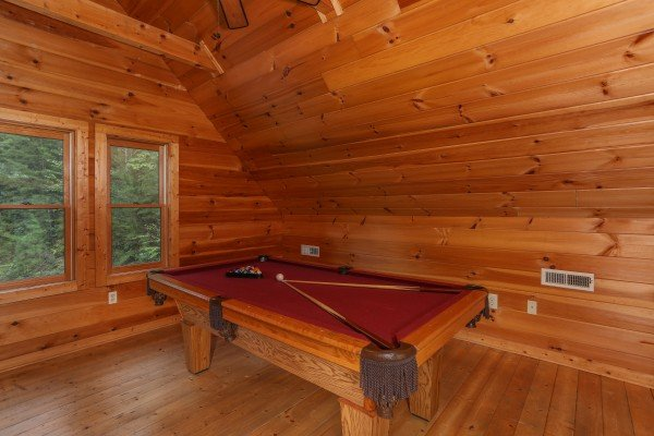Pool table in the game loft at Hidden Ecstasy, a 1-bedroom cabin rental located in Pigeon Forge